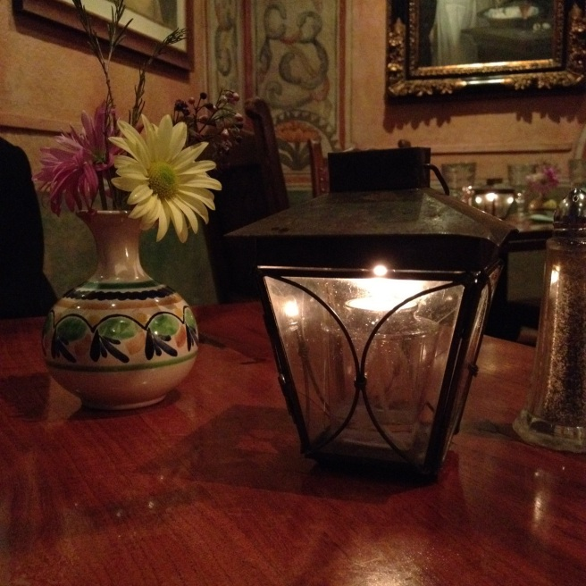 candle lantern and flower on table