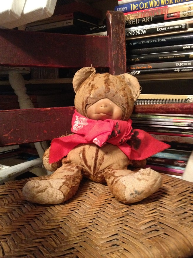teddy bear sitting in rocking chair