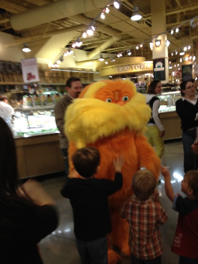 lorax surrounded by little kids